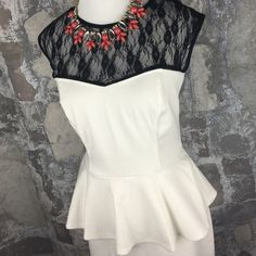 White and black lace cut out back peplum dress Brand new with tags! Size large. Zipper back and cute cut out back. Stretchy and super comfortable! Speechless Dresses