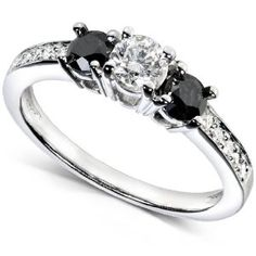 #blackdiamondengagement This beautiful black and white diamond engagement ring features one 1/4 carat white center diamond surrounded through two black diamonds of 1/Three carat total weight. Along the shank are 10 extra white diamonds giving this ring a total diamond weight of three/5 carat. - See more at: http://blackdiamondgemstone.com/jewelry/wedding-anniversary/engagement-rings/35-carat-tw-three-stone-black-and-white-diamond-engagement-ring-in-14k-white-gold-size-6-com/