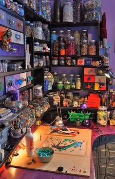I know it's a workroom, but it has the feeling I want for my kitchen :-) Shelves full of bottles and jars, filled with odd and interesting things, potions and lotions and powders and stuff...: