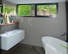 The ensuite bathroom features an oval bath