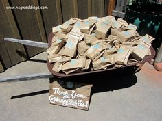 Our antique wheelbarrow overflowing with wedding favors...