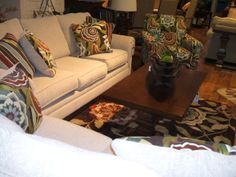 Love the print on the arm chair -- and the sofa has a a look to go in many different interiors. Great look for sun room!