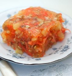Sunshine salad is a traditional congealed salad with pineapple, carrots and nuts.