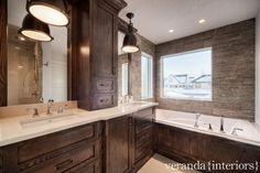 Veranda Interiors: Rustic monochromatic bathroom with coffee stained oak bathroom cabinets with stone ...