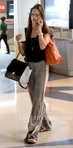 Seen on Celebrity Style Guide: Alessandra Ambrosio wore wide leg print pants by Ella Moss buying magazines at LAX airport in Los Angeles on July 7th 2013