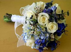 Wedding Bouquet Which Includes: Blue Hydrangea, Blue Delphinium, Ivory Roses & White Wax Flower
