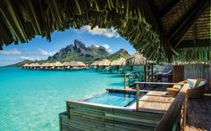 The Four Seasons Resort in Bora Bora is one of the most beautiful, vibrant, honeymoon-magnet spots in the world. One hundred and seven bungalows perch over the water with teak furniture and pandanus leaf roofs and feature sweeping views of Mount Otemanu.