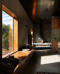 Combining polished wood with raw concrete block.  Kerstin Thompson Architects, House at Big Hill, Victoria, Australia