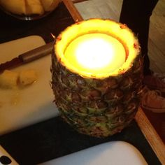 Carve out a pineapple and put a candle inside!! Great for Hawaiian parties!! Credit: ambers mom!