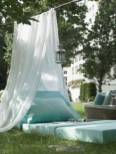 This simple outdoor reading space would be perfect for kids. And the best part? It's homemade DIY! Just combine chair cushions with a piece of fabric.