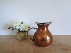Vintage Solid Copper Water Pitcher  Mid Century by WhiteElephantCo, $26.00. Visit our store @ whiteelephantco.etsy.com