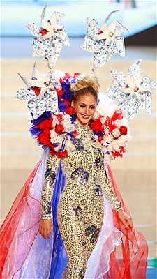Nathalie den Dekker shows off the national costume for the Netherlands  at the 2012 Miss Universe pageant.