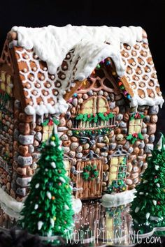 This masterpiece is created with the help of a chateau mold, so it's easier to make than it looks. To get the stone wall effect, use royal icing, sanding sugar, and food coloring.