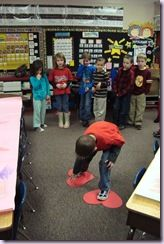 """Heart Lava - walk around the room using only two paper hearts without falling into the """"lava"""" (do not touch the floor)."""
