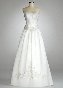 Be the essence of classic elegance in this timeless strapless ballgown.   Strapless satin ball gown with a beaded lace bodiceadds just the right amount of sparkle.  Lace up back.  Chapel train.  Available in Soft White. Sizes 2-16.  Fully lined. Imported polyester. Dry clean only.