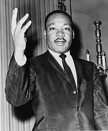 Martin Luther King Jr in 1977 receives the Presidental Medal of Freedom posthumously for his work in civil rights.