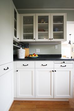A kitchen project by Hammer and Hand, located in Portland.  Refaced cabinets with bronze hardware from House of Antique Hardware