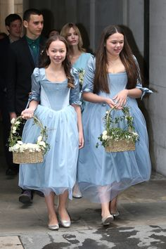 Even the flower girls followed suit, adding to the fairytale vibe of the day as they toted their blossoming wicker baskets in Cinderella-esque blue satin gowns and dainty sterling slippers.