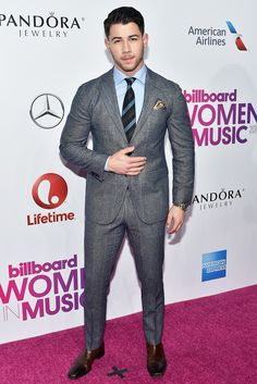Nick Jonas was in attendance at Billboard's annual Women in Music event, held at New York's Pier 36 on Friday morning. He wore an Etro design. Dapper Gentleman, Gentleman Style, Dapper Men, Nick Jonas, Lucio Saints, Father Of The Bride Outfit, Best Dressed Man, Women In Music, Mens Boots Fashion