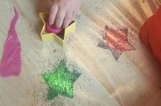 Glitter stars.. contact paper sticky side up glitter and cookie cutters!!! Really effective...
