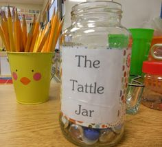 "Tattle Jar.  Every time they ""bad tattle"" they have to put a marble in the Tattle Jar.  Once it's filled up there's a consequence."