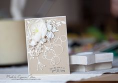 layered card using large ringlets, wildflower corner and  beach sprig. Simply beautiful.