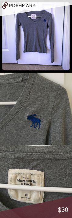 Gray long sleeve A&F tee Heather gray long sleeved v-neck tee with logo accented L sleeve and logo of moose on front left chest area. Great condition, soft and comfortable Abercrombie & Fitch Tops Tees - Long Sleeve