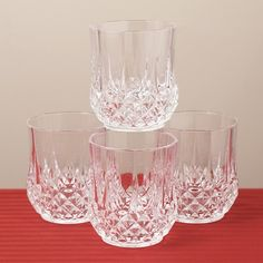 """OLD FASHION WHISKY JUICE OR WATER GLASSES      Longchamp D'ARQUES Crystal Set of 4 Old Fashion Glasses         The sparkling Crystal Longchamp Set of 4 Old Fashion Glasses each measure 10.75oz capacity.    They are Made in France.    The deep diamond cuts brilliantly refract light.     Diamex - non lead Crystal    Product Measurements:    Height 3.75""""    Care Instructions    •Dishwasher Safe"""