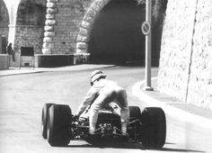 Nothing compares to the glamor of Monaco. Here Graham Hill gives a lift to Jackie Stewart (1967).