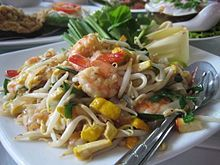 "Pad Thai is of Vietnamese origin & uses pho noodles & Chinese ingredients. In Vietnam, it is called ""phở xào"", meaning ""stir-fried pho"", with sate (garlic, peanuts, & chiles), mung bean sprouts, meat, scallions, & fish sauce, often served with pickled vegetables. The dish was said to have been imported to the ancient capital city of Thailand by Viet traders, & was then altered to fit Thai tastes & the name changed to reflect its new Thai-ness."