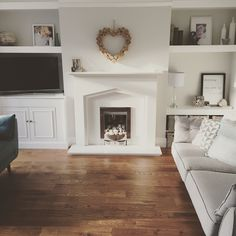 Living room Built in shelves Shelves in the alcoves White fireplace Living room design