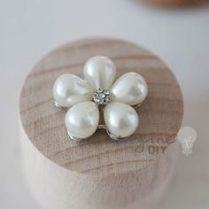 Pearl embellishment in flower shape. Pretty pearl decoration for DIY wedding stationery and invitations