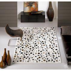 Carving Alfombra moderna Rocking Alfombra moderna Rocking Carving fabricada a mano 70% en lana y 30% en piel. El diseño consiste en círculos de diferentes...