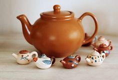 Cute little brown betty tea-pots.