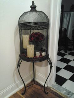 I love the idea of using a bird cage for candles & decorative accents. Even books!