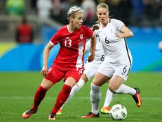 Sophie Schmidt (L) of Canada and of Amandine Henry of France in action during the match between Canada and France womens football quarter final for the Olympic Games Rio 2016 at Arena Corinthians on August 12, 2016 in Sao Paulo, Brazil. (Source: Alexandre Schneider/Getty Images South America)