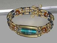 I like how the metal tubing is used and combined with the wire and beads. Desiree's Polymer Clay Gallery #5 - Bracelets