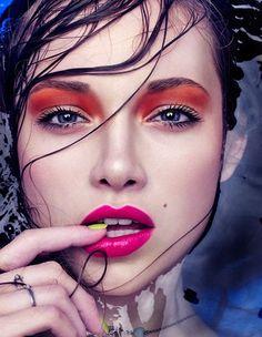 Red eyeshadow, pink lips, yellow nail polish, bright colors, creative makeup idea, blue eyes