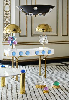 A futuristic collection of bold Lucite spheres and cabochons, the Jonathan Adler Globo collection is sure to transport your living room into an entirely different dimension of glam.