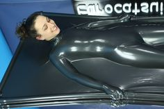 girl in vacbed made from metallic pewter latex