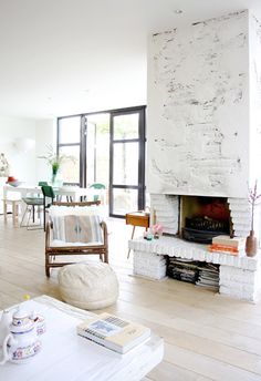 Eclectic modern home, white brick fireplace, light wood floors Brick Fireplace, Living Room With Fireplace, Home Living Room, Living Spaces, White Fireplace, Brick Hearth, Living Area, Fireplace Windows, Ceiling Windows