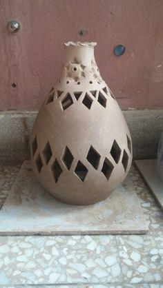 Clay pierced lantern, ready for firing