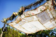 Canopy of vintage fabric for ceremony site