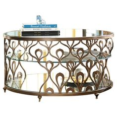 Bring a touch of glam to your living room or den with this eye-catching coffee table, showcasing an ogee-inspired metal frame and a round glass top....