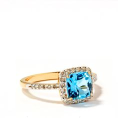 A vivid brilliant cut 1.97ct swiss blue topaz set in 10k gold and surrounded by glittering diamonds which extend along the delicate accents. This ring gives the much adored classic style a modern makeover with a flash of ocean blue color and is from our iconic collection, The Classics.  All pieces are made with conflict free stones and are independently hallmarked. We supply a certificate of authenticity with every purchase ensuring added peace of mind.