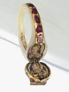 This ring of Queen Elizabeth opens at the hinge to reveal an enameled portrait of her ca. 1575 and that of an unnamed woman dressed in Edwardian clothing.  It may be her mother, Anne Boleyn.
