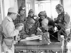Pilots of the Kokutai, based at Omura Airfield, near Hiroshima, assess a map before setting off to intercept an American bombing raid, 1945 Us Marines, Fighter Pilot, Army & Navy, Modern History, World History, Military History, World War Two, Armed Forces, Wwii
