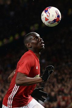 Manchester United's French midfielder Paul Pogba keeps his eys on the ball during the EFL Cup fourth round match between Manchester United and...