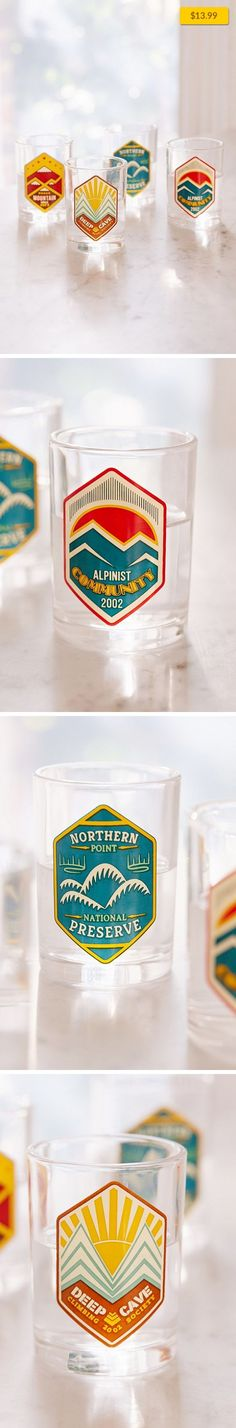 """Retro Camping Logo Shot Glasses Set Apartment, Kitchen + Bar   Set of shot glasses perfect for sharing with friends around the campfire, print with retro camping logos at the front. Comes with 4 assorted shot glasses. Content + Care - Set of 4 - Glass - Hand wash - Imported Size - 4 oz - Dimensions: 3""""h x 2.5""""diameter"""