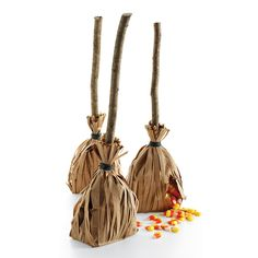 Witch's broom treat bag. Use 2 paper bags, one with sides cut like fringe. Place the normal bag into the shredded bag, fill with treats, place a stick inside, and tie closed.